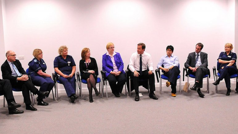 David Cameron talking to doctors and nurses