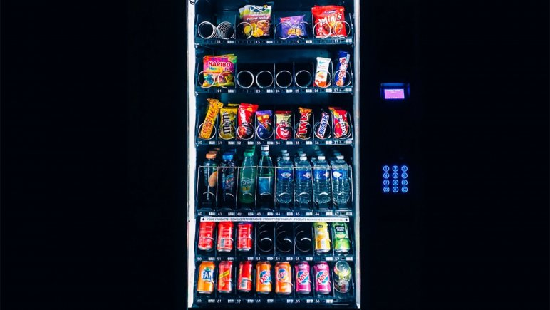 Vending machine set against black background