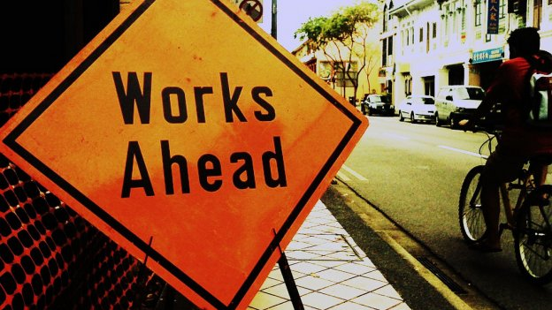 works ahead sign