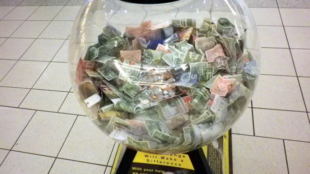 picture of collection box full of notes