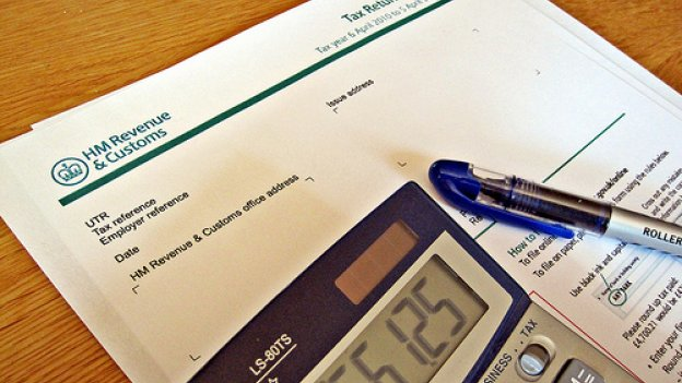 image of tax form and calculator