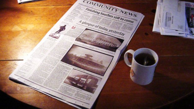 picture of newspaper and cup of tea