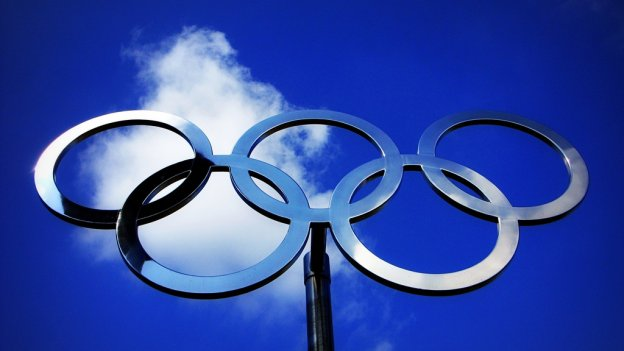 Olympic rings against the sky