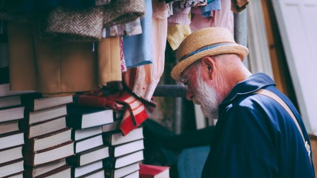 elderly man browsing books