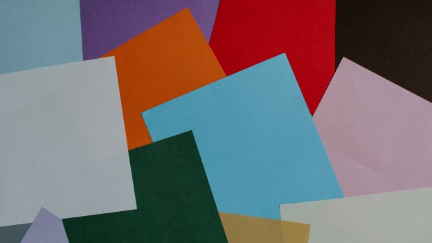 different coloured pages of paper overlapping