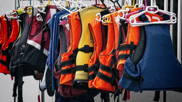 Life jackets hanging on rail