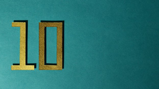 Number 10 in gold against a turquoise blue background