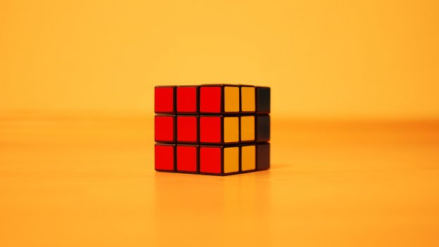 Image of rubik's cube against a yellow background
