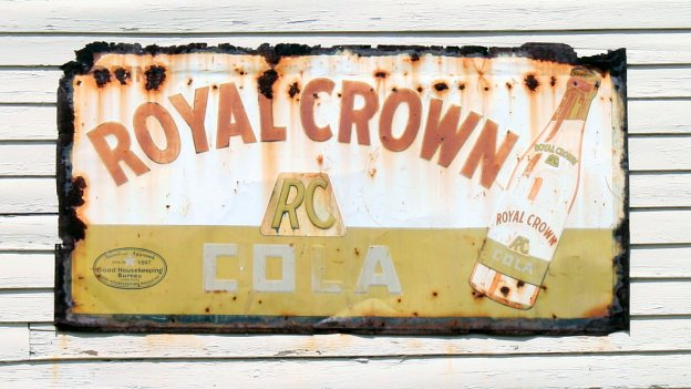 Photo of yesteryear branding - a painted sign