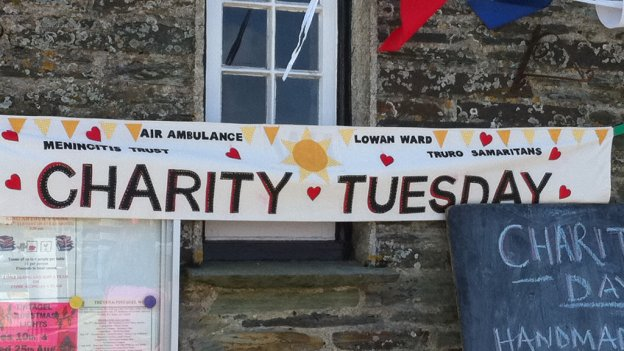 Banner for Charity Tuesday at local charity event