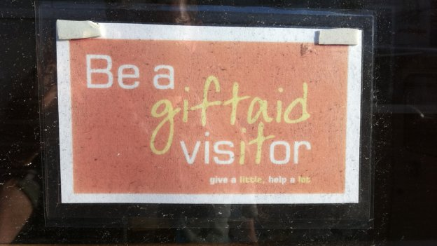 Gift Aid sign in a window