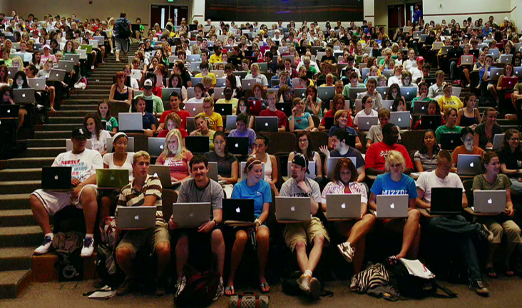 Lecture hall with students and their mac computers